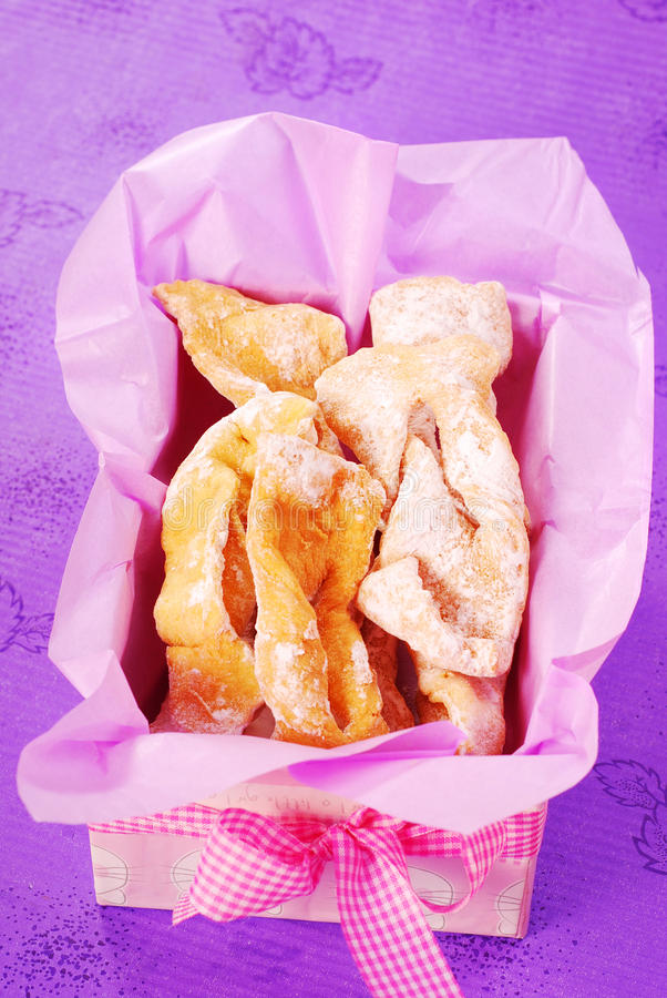 Deep-fried pastries with icing sugar royalty free stock photos