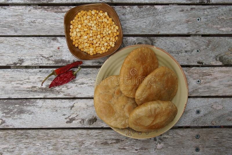 A deep fried poori or kachauri with sicy lenti filling royalty free stock images