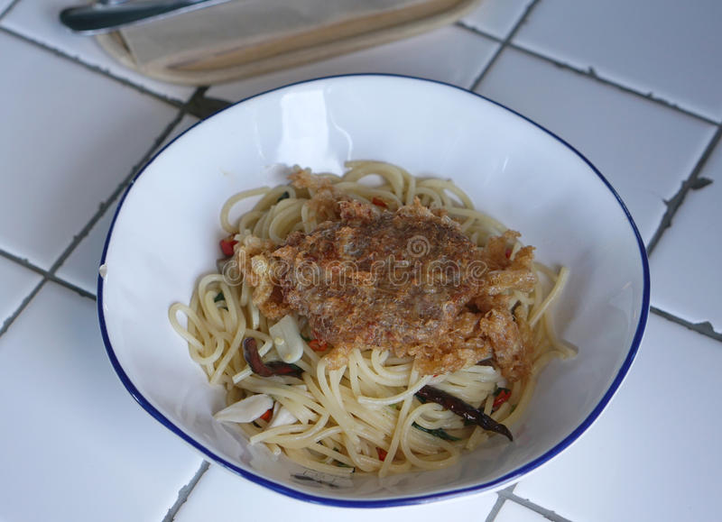 Deep fried pork ball spaghetti. Homemade Deep fried pork ball spaghetti with garlic and dried cayenne pepper stock photo
