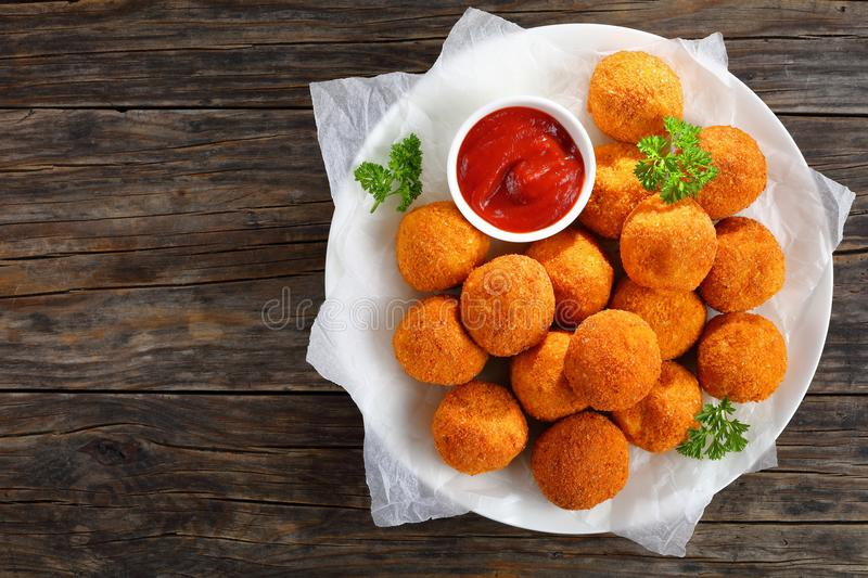 Deep fried potato croquettes with sauce royalty free stock photography