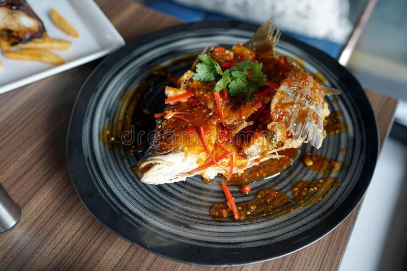 Deep fried Sea bass with sweet and sour sauce. stock photos