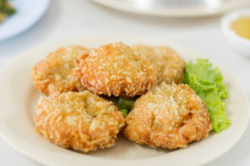 Deep fried shrimp cakes (Tod Mun Goong). Deep fried shrimp cakes (Tod Mun Goong) in Thai style restaurant serve with Chinese plum sauce stock photography