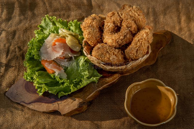 Deep-fried shrimp cakes Tod Mun Goong and vegetable with chili sauce on wooden background. Thai cuisine royalty free stock photos