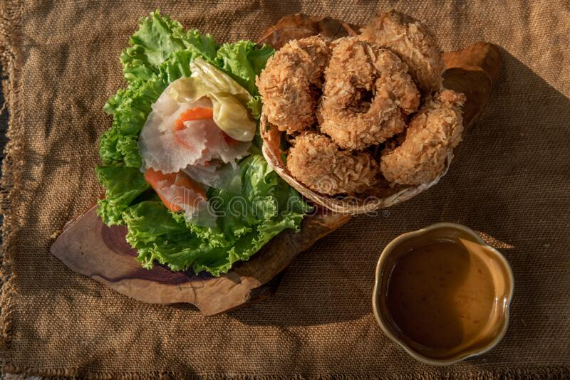 Deep-fried shrimp cakes Tod Mun Goong and vegetable with chili sauce on wooden background. Thai cuisine stock image