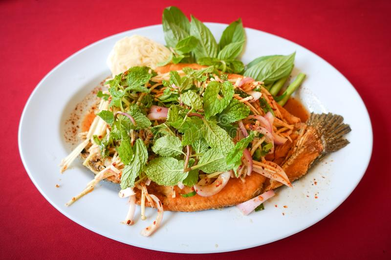 Deep fried Snake-head fish with Mixed Herb, Thai food. Pla Shon Lui Suan stock image