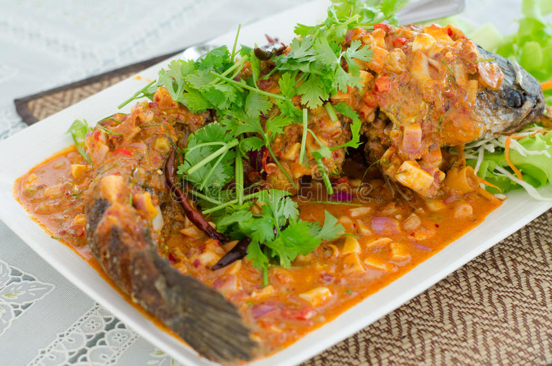 Deep Fried Snakehead Fish with Herb and Spicy Sauce stock photography
