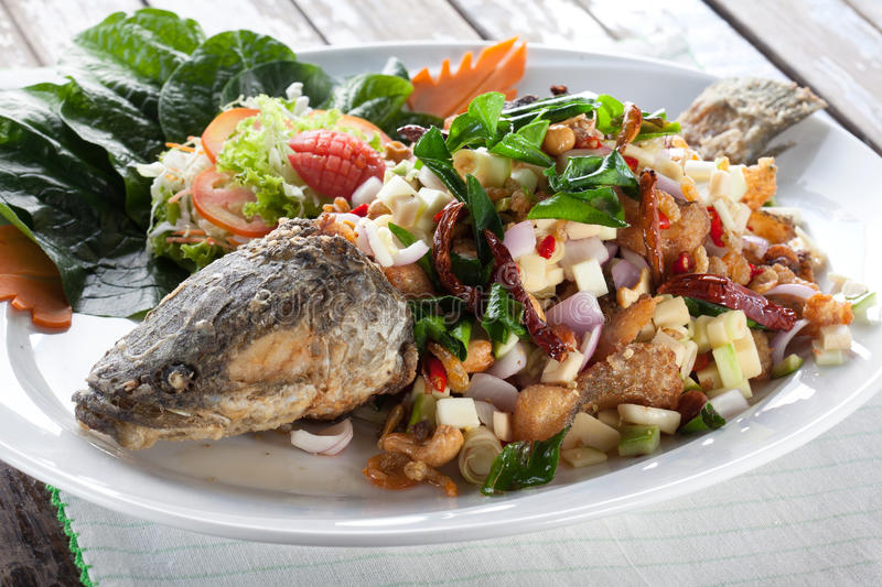 Deep Fried snakehead Fish with Thai Herb stock images