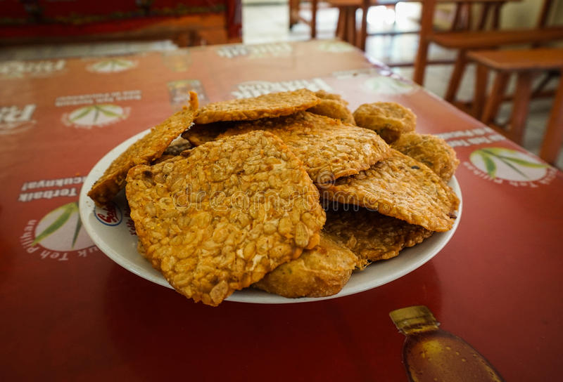 Deep fried tempeh and potato fritters on a plate already served in a restaurant photo taken in Semarang Indonesia. Java stock photo