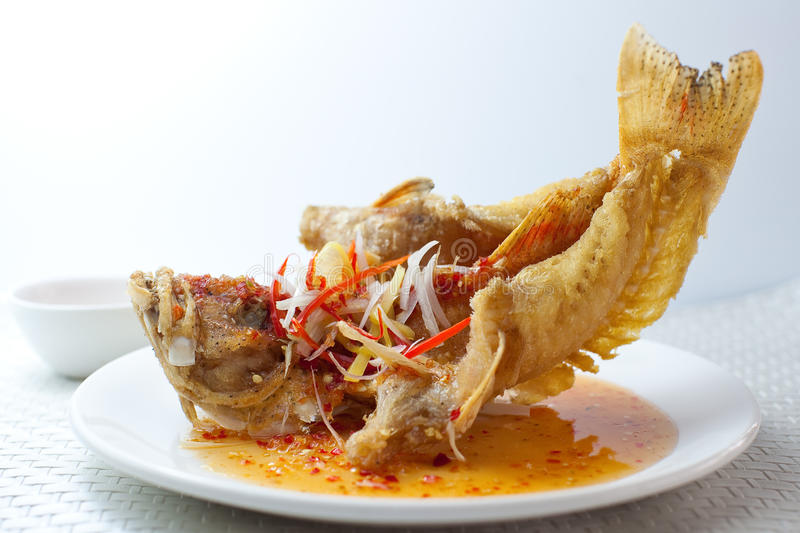 Deep Fried Thai Style Fish. On a plate royalty free stock photos