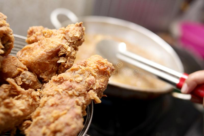 Deep Fry Fried Fried Chicken. Close up image of cooking deep fry fried chicken, hot fat fryer in home kitchen oil unhealthy meat meal food closeup eating tasty royalty free stock images