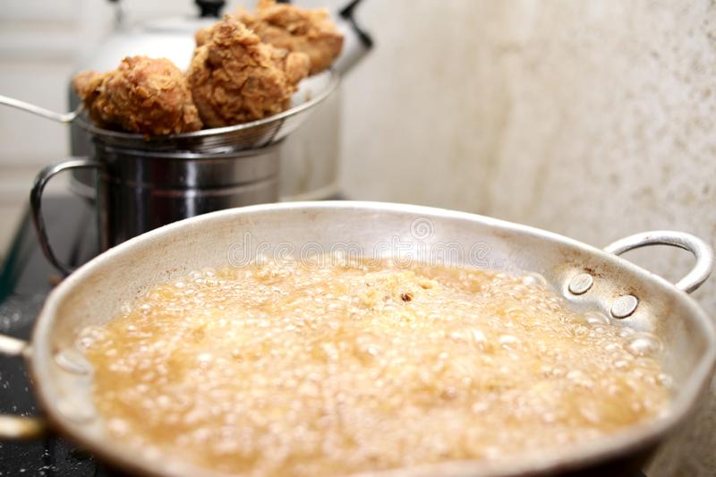 Deep Fry Fried Fried Chicken. Close up image of cooking deep fry fried chicken, hot fat fryer in home kitchen oil unhealthy meat meal food closeup eating tasty stock photography