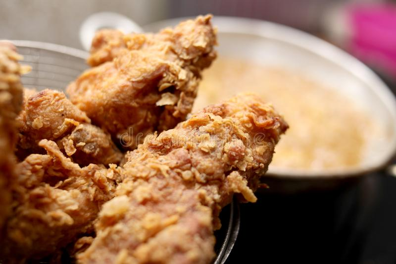 Deep Fry Fried Fried Chicken. Close up image of cooking deep fry fried chicken, hot fat fryer in home kitchen oil unhealthy meat meal food closeup eating tasty royalty free stock photos