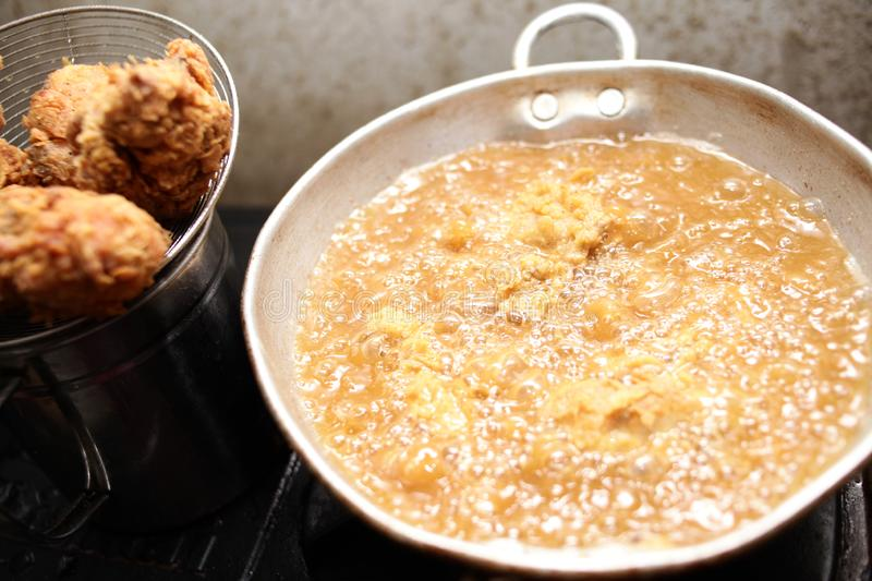 Deep Fry Fried Fried Chicken. Close up image of cooking deep fry fried chicken, hot fat fryer in home kitchen oil unhealthy meat meal food closeup eating tasty royalty free stock photo