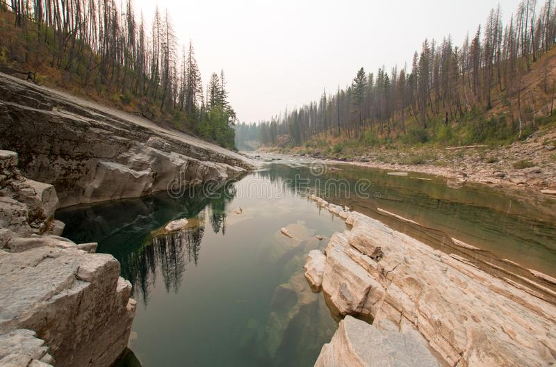 Deep Green Pool of still water in Meadow Creek Gorge in the Bob Marshall Wilderness area in Montana USA. Deep Green Pool of still water in Meadow Creek Gorge in stock photography