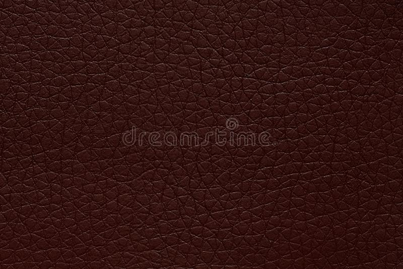 Deep leather texture in exciting colour. Dark brown leather background. High resolution photo stock image