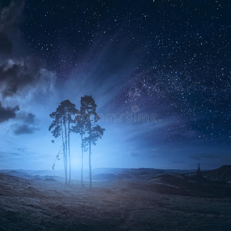 Deep night in a mountain valley. With majestic rising of the full moon royalty free stock photography
