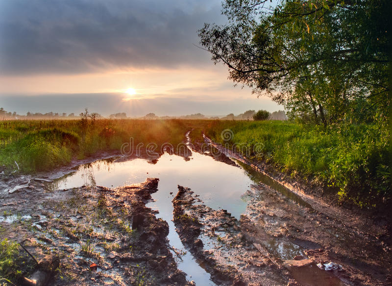 Download Deep puddle on a road stock photo. Image of ground, horizon - 26084560