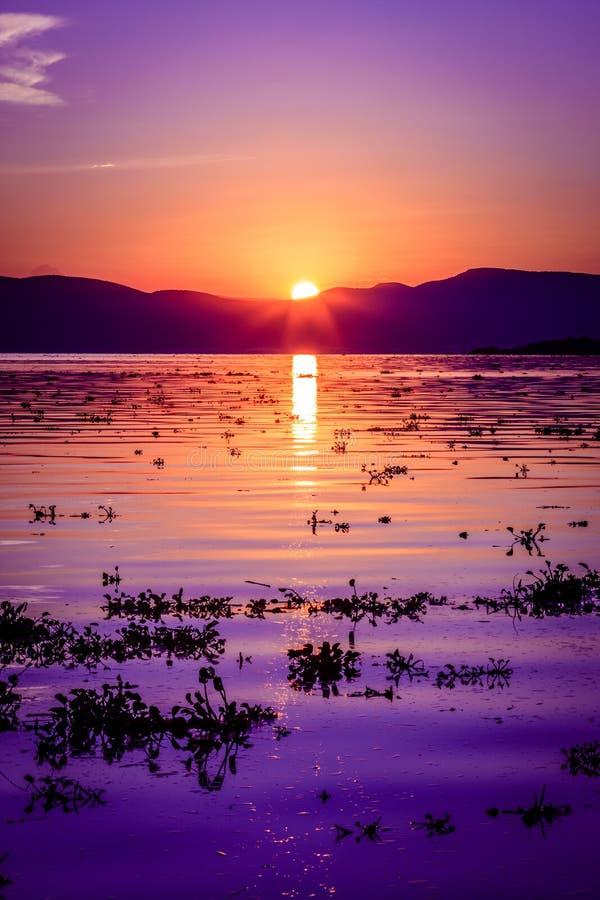 Deep majestic purple sunset reflecting over a rippled Lake Chapala in Ajijic Mexico. Deep purple sunset reflecting over a rippled Lake Chapala in Ajijic Mexico stock image