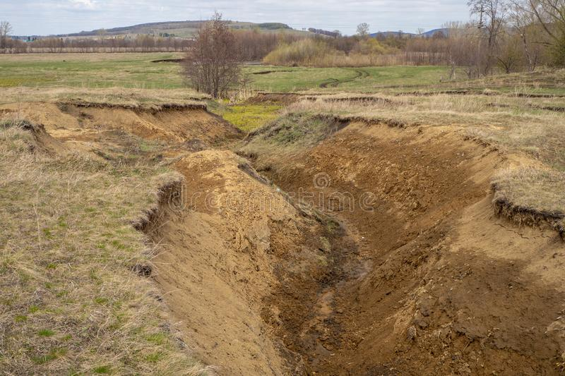 Deep ravine. Caused by soil erosion from spring thawed waters royalty free stock photos