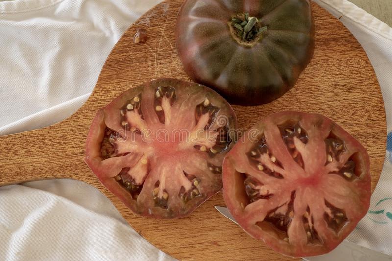 Deep red and dark green colors of Heirloom tomatos royalty free stock images