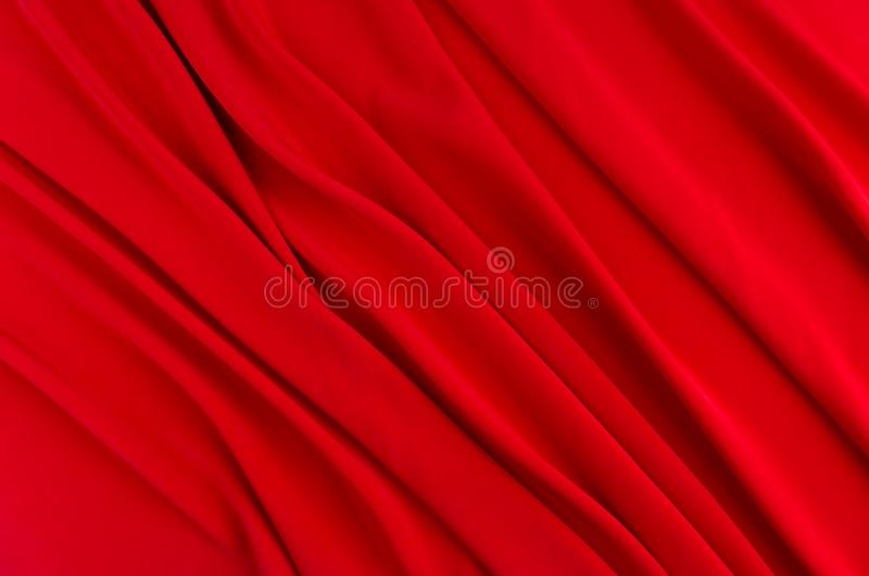 Deep red silk smooth background with copy space. Abstract passion love backdrop. stock images