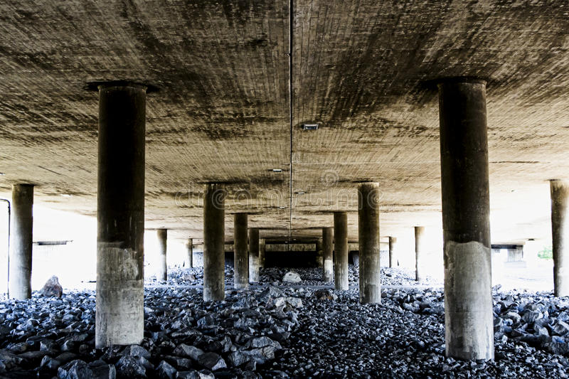 Deep and rough perspective from under a concrete bridge royalty free stock image