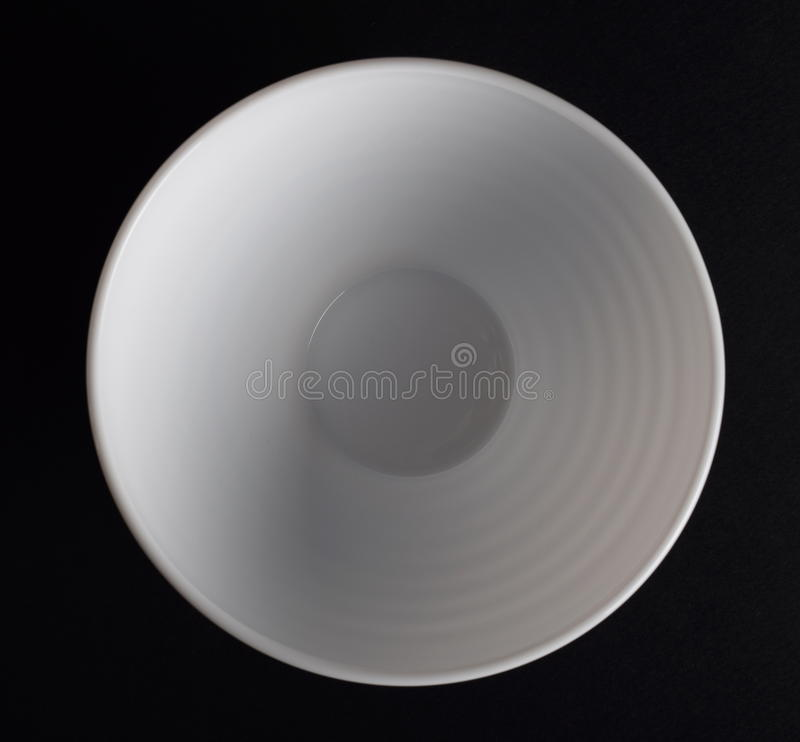 Deep round porcelain dish. White bowl top view stock images