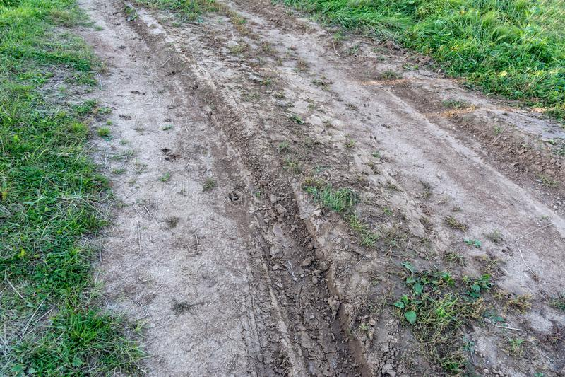 Deep ruts with water from a tractor. On the edge of rural fields stock image