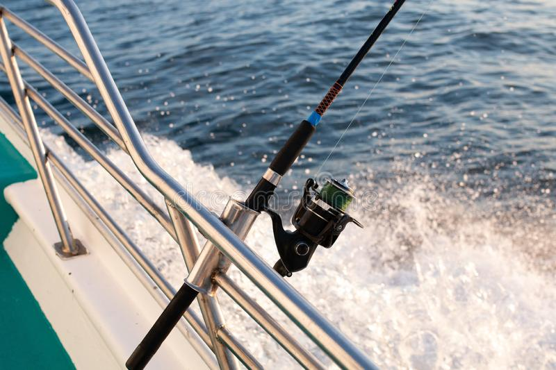 Fishing pole on a yacht. Deep sea fishing pole on the yacht in the Pacific Ocean royalty free stock images