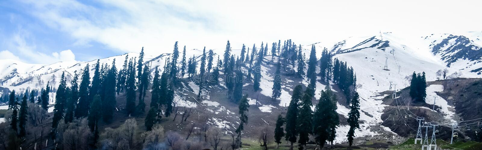 Deep Snow covered Himalayan mountain and Winter white forest landscape view. Inspirational Panorama view. Christmas Holiday season royalty free stock images