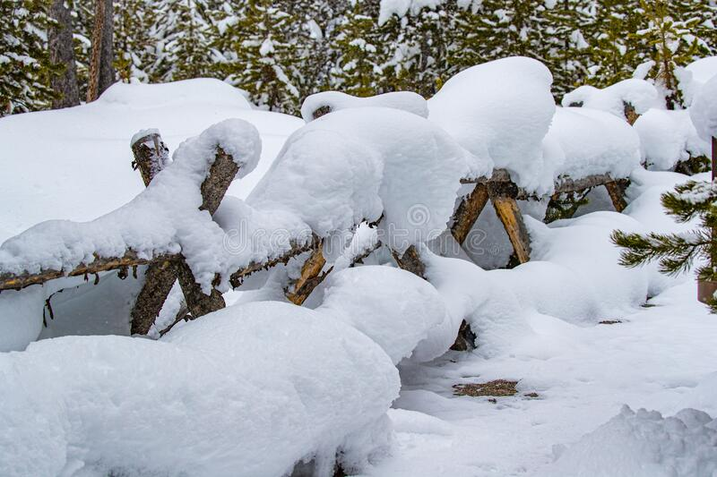 Deep snow covers fencing in Yellowstone in Winter. Deep snow covers fencing in Yellowstone National Park in Winter royalty free stock images