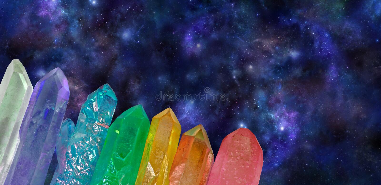 Deep Space Cosmic Aura Wands. Wide dark blue outer space background with seven chakra colored crystal wands spanning bottom left corner diagonally providing stock photos