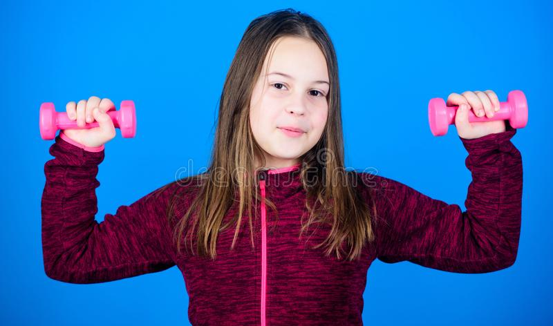 Deep squat. Happy child sportsman with barbell. workout of small girl hold dumbbell. weight lifting for muscules. Childhood activity. Fitness diet for energy stock images