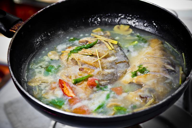 Deep submerged oil fried Pomfret fish thai style curry royalty free stock photos