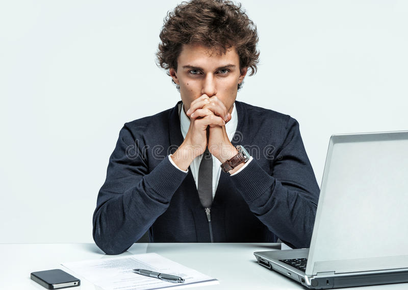 Deep in thought man. Businessman at the workplace stock image