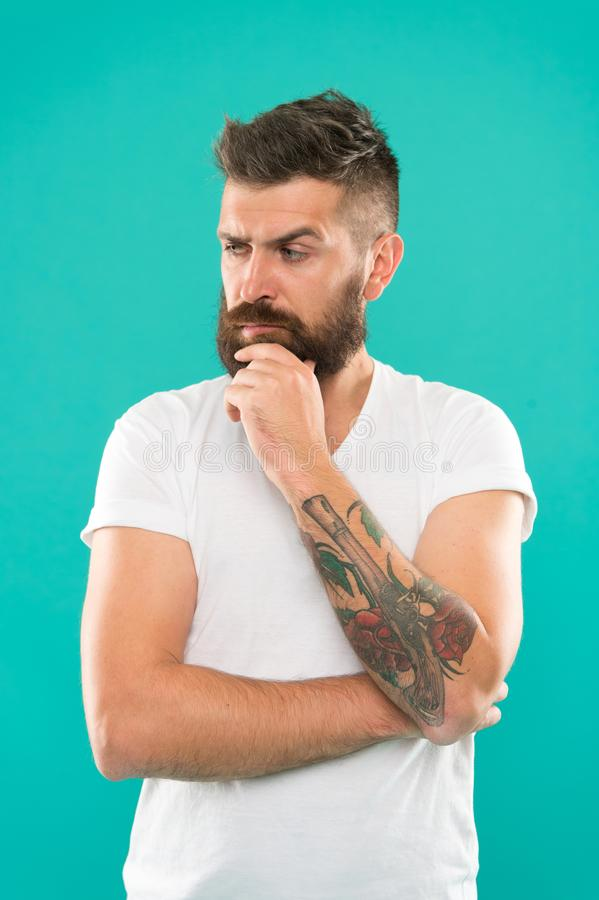 Deep thoughts. Man serious face not confident. Have some doubts. Hipster bearded face not sure in something. Doubtful stock images