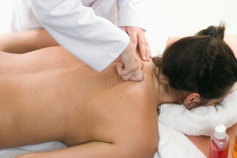 Deep Tissue Massage. A woman receives a deep tissue massage with kneading. Kneading is a massage technique in the category of petrissage movements stock photos