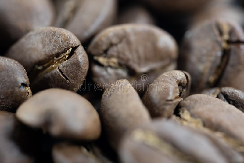 Deeper closeup of a pile of coffee beans. Closeup of a pile of dark coffee beans royalty free stock photography
