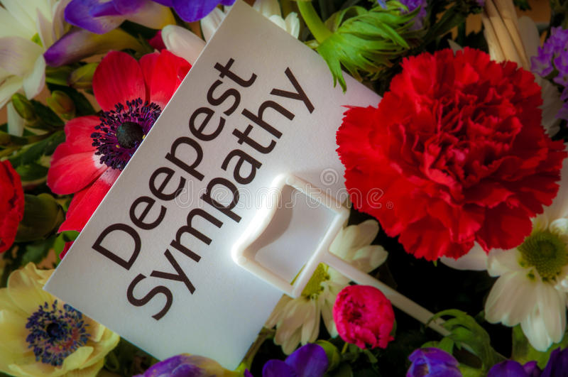 Deepest Sympathy card in flowers stock photography