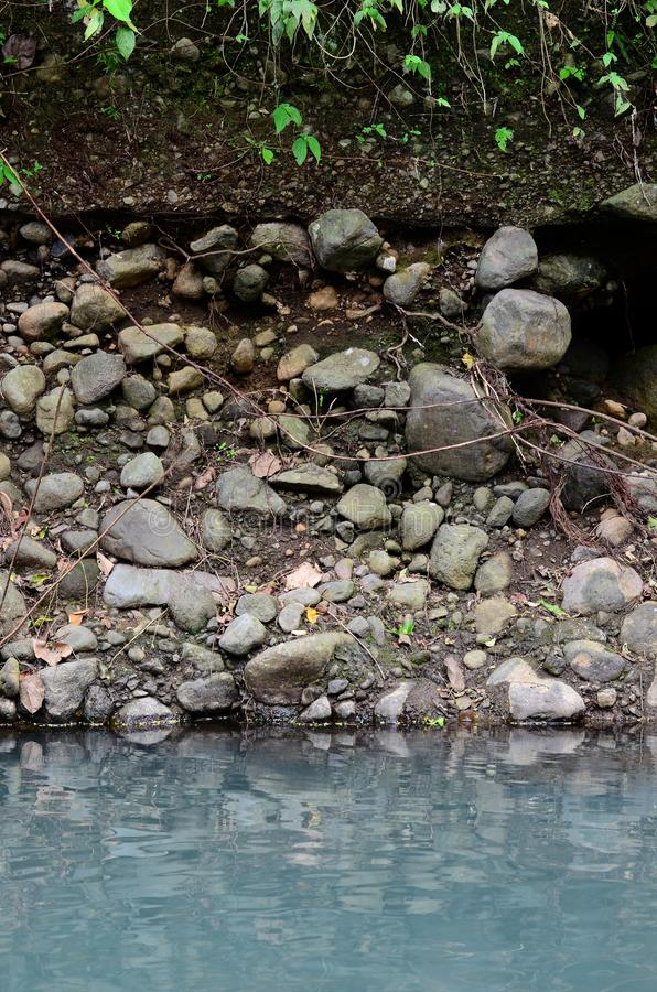 Deeply eroded river bank due to previous flooding. Brought about by illegal logging activities stock image