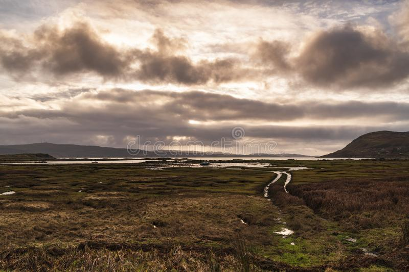 Rutted Track. A deeply rutted track near Kilchoan leading down to Loch Sunart with the Isle of Mull in the background, Ardnamurchan, Scotland royalty free stock photography