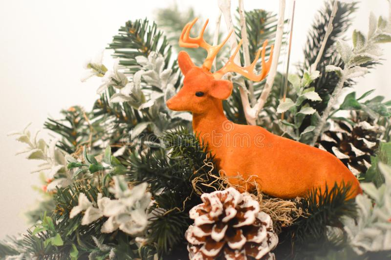 Deer Christmas Decoration with Pine Cones. A deer with antlers Christmas decoration with pine cones and evergreen branches royalty free stock image