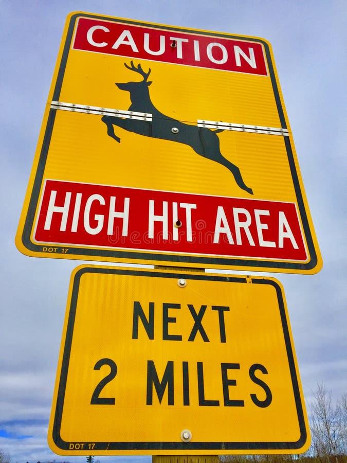 Deer crossing warning sign stock image