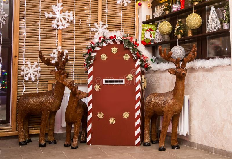 Deer and a mailbox for letters to Santa Claus royalty free stock image