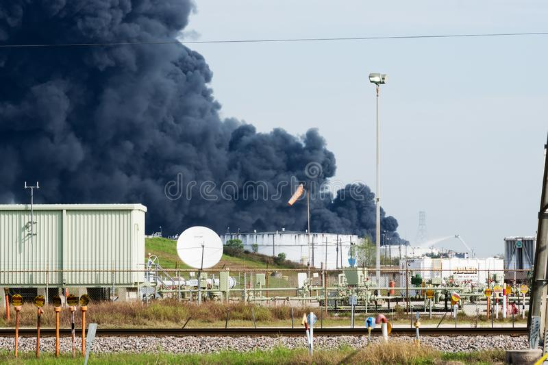 Deer Park, Texas / United States - March 19, 2019: Multiple tanks burn at Deer Park chemical facility. A massive plume of black stock photo