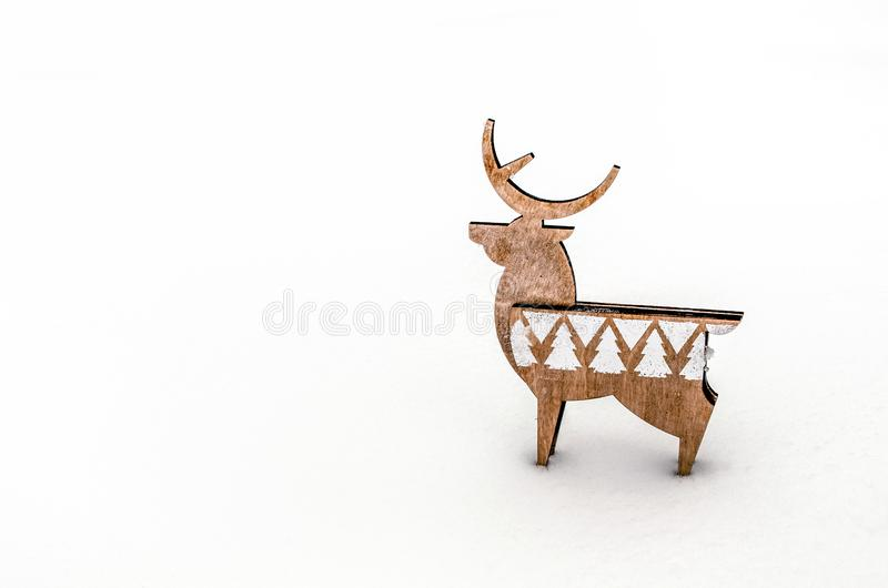 Deer of plywood on white snow. stock photography