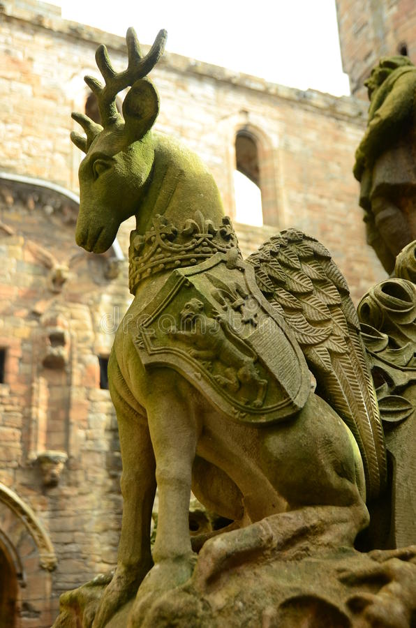 Deer Sculpture. A view of a stone deer carving on the intricate fountain in Linlithgow palace stock image