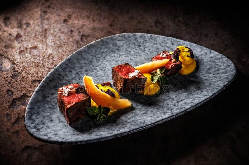 Deer sirloin with sweet potato puree stock photos