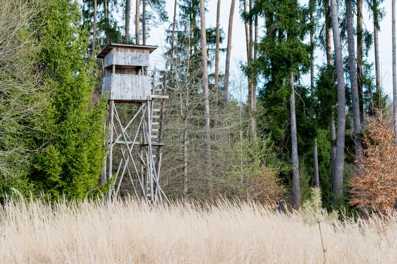 A deer stand in front of a meadow in the Natural Reserve schoenbuch in Germany stock images