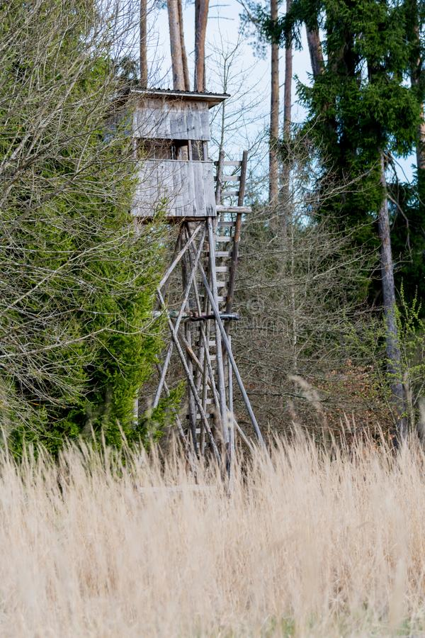 A deer stand in front of a meadow in the Natural Reserve schoenbuch in Germany royalty free stock photography